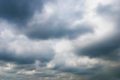 Cloudy sky full of deep grey clouds Stock Photos