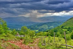 Cloudy sky. With heavy rain at countryside, Romania royalty free stock photo