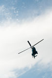Cloudy sky with helicopter Stock Image