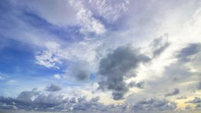 Cloudy sky in horizontal line. On blue background Stock Image
