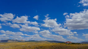 Cloudy sky. House under beautiful cloudy sky Stock Image