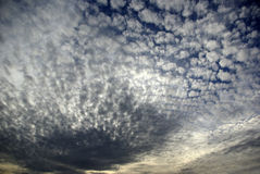 Cloudy Sky. Late afternoon deep blue sky with clouds, white to deep grey Stock Image