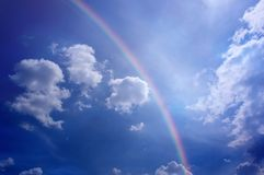 Cloudy blue sky with magic rainbow and light stock photos