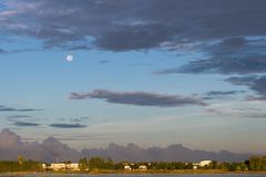 Cloudy sky and moon early morning. Royalty Free Stock Images