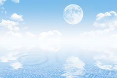 Cloudy sky with moon and sea Stock Images