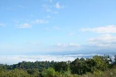Cloudy sky with mountain mist Stock Photos