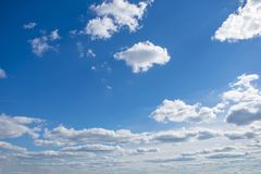 Cloudy sky with natural sun flare. Clouds. Free sky stock photo