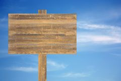 Cloudy sky with old wooden sign Stock Photography
