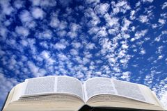 Cloudy sky and open book 04. Sheep clouds and a blue sky background Stock Images