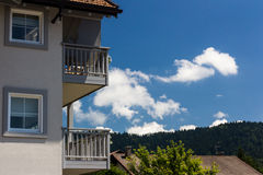 Cloudy Sky Outside of a Balcony. A nice summer sky outside of an holiday house in the Alps Stock Photo