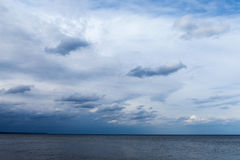Cloudy sky over Baltic sea. Royalty Free Stock Images