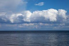 Cloudy sky over Baltic sea. Stock Photo