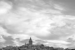 Cloudy Sky over Beyoglu, Istanbul, Turkey. In black and white. Cloudy sky occupies most of the picture. Buildings, including Galata Tower, in Beyoglu, known as Stock Images