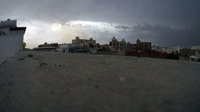 Cloudy sky over building surface at noon time lapse. In south jeddah stock footage