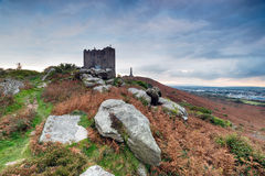Cloudy Sky over Carn Brea. Clouds gather over Carn Brea castle above Redruth in Cornwall Stock Photos