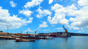 Cloudy sky over Chatham Island. Cloudy seascape from Chatham Island. Ships and boats at the jetty in foreground, Port Blair, Andaman and Nicobar Islands, India Stock Photos