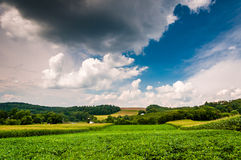 Cloudy sky over farm fields in rural York County, Pennsylvania. Royalty Free Stock Image