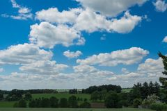 Cloudy sky over a field Royalty Free Stock Photo