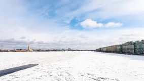 Cloudy sky over frozen Neva river with polynya. Blue cloudy sky over frozen Neva river with polynya, Dvortsovaya Embankment and Peter and Paul Fortress in Saint Royalty Free Stock Photo