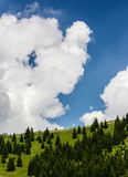 Cloudy Sky Over an Hill. Detail of a summer sky over an hill in the Alps Stock Image