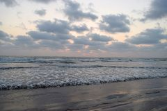 Cloudy Sky over Infinite Ocean at Ladghar Beach - Natural Sunset Wallpaper Stock Photography