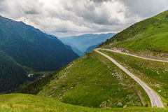 Cloudy sky over motorcycle roads in Carpathians, Romania. Cloudy sky over winding motorcycle road, Carpathians, Romania Royalty Free Stock Photo