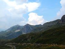 Cloudy sky over mountain Durmitor. Mountain road under the cloudy sky stock photos