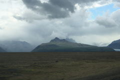 Cloudy sky over mountains in Iceland Stock Photos