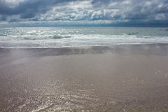 Cloudy sky over the ocean. In cool colors Stock Photos
