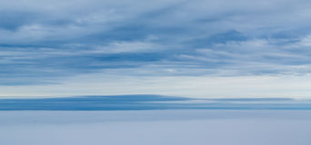Cloudy Sky Over Ocean. Cloudy Sky Over Grey Ocean royalty free stock images