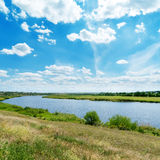 Cloudy sky over river Royalty Free Stock Photo