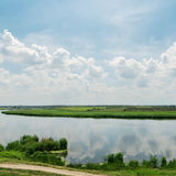 Cloudy sky over river Royalty Free Stock Photos