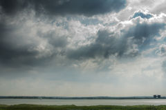 Cloudy sky over the river Thames, Grays, Essex Stock Image