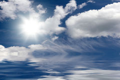 Cloudy sky over the sea. With sun Stock Photography