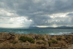 Cloudy sky over the sea. For travel with wind and wild sea stock photos