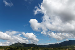 Cloudy sky over summer mountains. Copy space Royalty Free Stock Photo