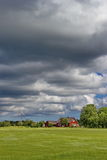 cloudy sky over traditional estonian rural house royalty free stock image
