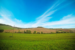 Cloudy sky over a Tuscan valley Stock Images
