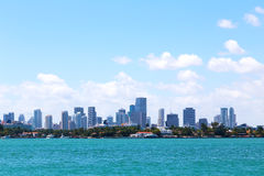 Cloudy sky over the water and Miami city, Florida. Stock Image