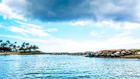 Cloudy sky and palm trees at Ko Olina Lagoon 3, named Nai`a Lagoon Stock Images