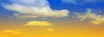 Cloudy sky panorama. Overlaid with yellow colour Stock Image