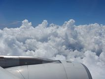Cloudy sky from plane. Blue sky with clouds from flying plane stock photography