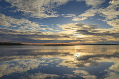 Cloudy sky reflected in the lake Royalty Free Stock Image
