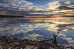 Cloudy sky reflected in the lake Stock Photos