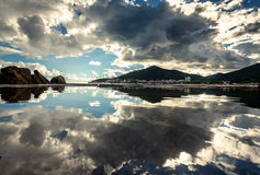 Cloudy sky reflecting in sea water surface Royalty Free Stock Image