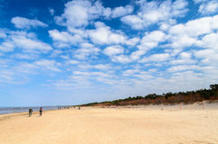 Cloudy sky and sandy beach of Baltic sea near Riga Royalty Free Stock Photo