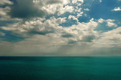 Cloudy sky and sea Stock Images