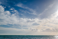 Cloudy sky sea Stock Images