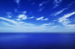 Cloudy sky and sea Stock Photos