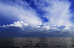 Cloudy sky and sea Stock Photos